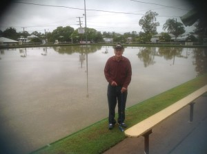 Paul Reynolds stands beside the the bowling green at North Ipswich Bowls Club. Swimming not Gateball is the only thing on offer.