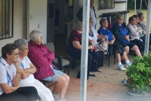 Watching the action were many people seated on the verandah.