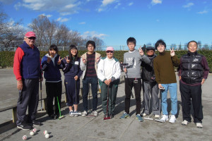 Keiichi, Jim and Barbara standing with a group of young players.