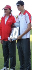 Lee and Christopher Wentworth holding the trophy for the third time.