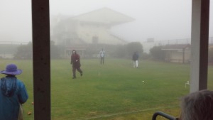 Referee is Bruce McAlister seen through the rain.