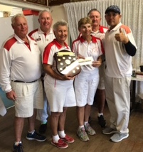 Southport Red team display the Perpetual Trophy upon which their name will be written for the first time.